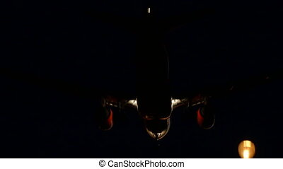 Commercial Aircraft Landing at Barcelona Airport at Night -...