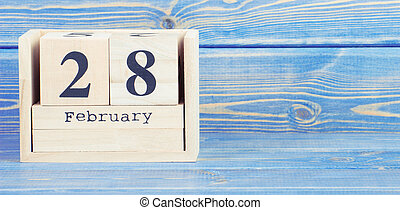 Vintage photo, February 28th. Date of 28 February on wooden cube calendar
