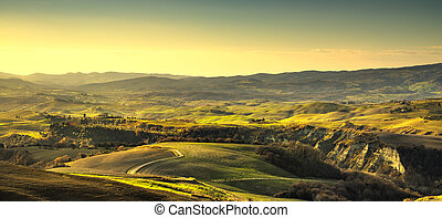 Volterra panorama, rolling hills and green fields. Tuscany, Italy
