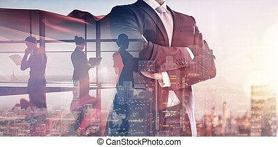 superhero businessman looking at city skyline at sunset. the...