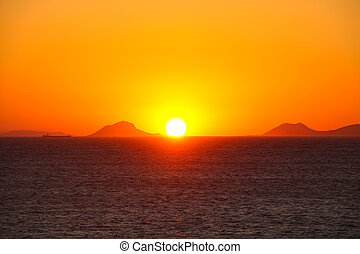 Sunset over sea water