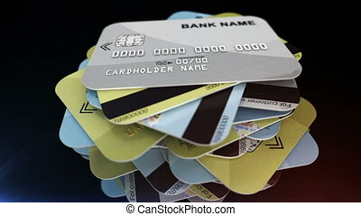 """A pile of credit cards rotates"" - ""A pile of credit cards..."