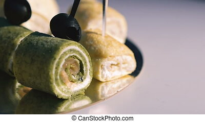 Rotating background with taste snacks on skewers.