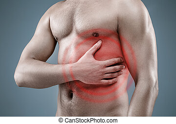 Young man having heart attack - Young man with niked torso...