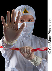 Portrait of a worker in protective clothing prevents entry...