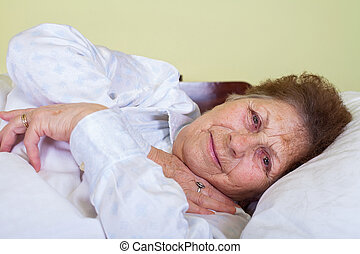 Sick old lady in bed - Picture of a sick old lady in bed at...