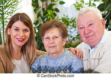Senior couple with cheerful caregiver - Picture of a senior...