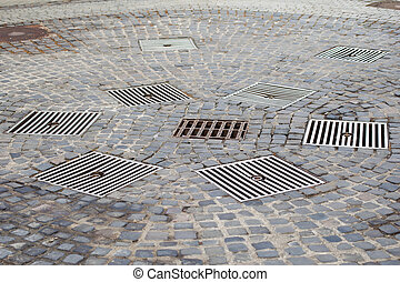 Drains in the city - Close up picture of a drains in the...