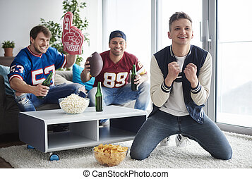 Young men watching American football competition