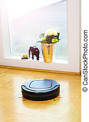 Robot vacuum cleaner in the living room