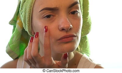 girl with a towel on her head causes cream to face - girl...