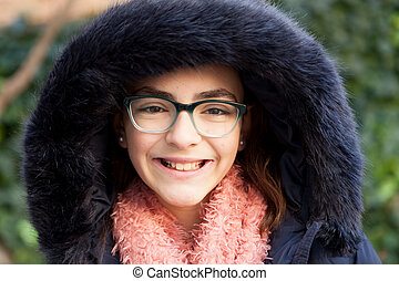 Smiling preteen girl in the park at winter - Smiling preteen...