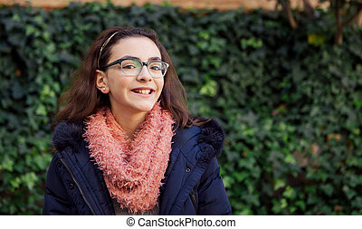 Smiling preteen girl in the park at winter