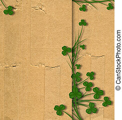 Greeting Card St. Patrick on old paper with green leaves of...