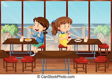 Two girls eating in the canteen