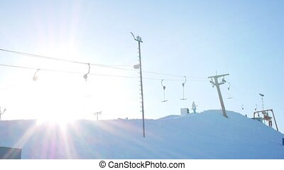 Ski lifts. Summy winter day. 4k video resolution.