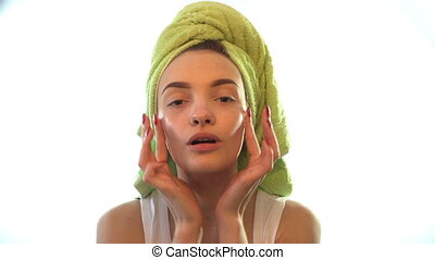 a young girl with a towel on her head tenderness causes...