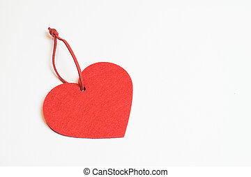 Be my love - Red heart, symbl of love, on a white background...