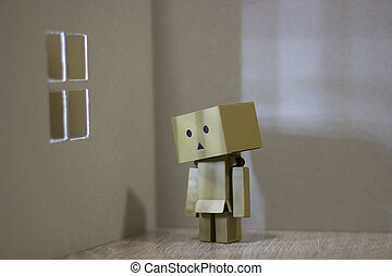 Lonely Danbo in front of the window