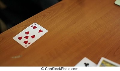 People playing cards on table