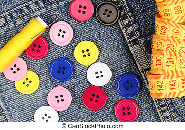 sewing supplies on denim - Colorful sewing supplies close up