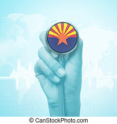 hand holding stethoscope with Arizona flag.