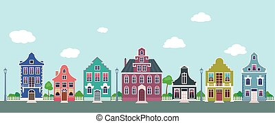 Colorful facades of the old houses on a city street.eps