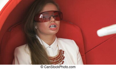 Young woman client at teeth whitening procedure - Young...