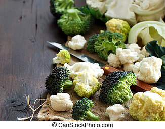 Fresh raw cauliflower and broccoli on an old wooden table