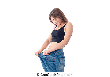 Slim young girl wore big wide jeans isolated on white...