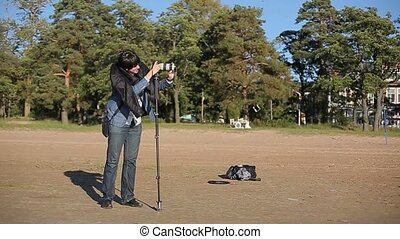 Cameraman working with monopod and camera