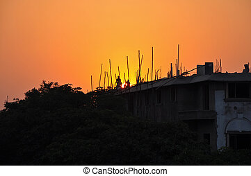 Indian Workers During the Sunset