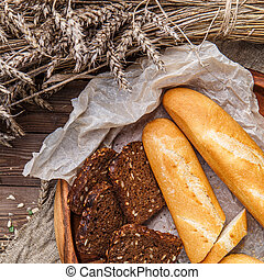 Loaf, bread in wooden bowl - Loaf, with black bread in...