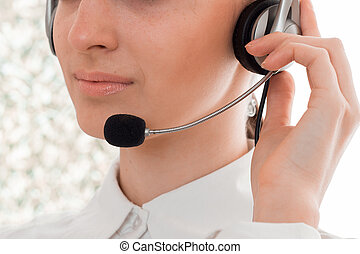 close up of young beautiful call center worker girl with...