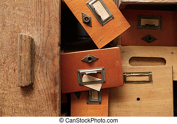 Disorderly group of wooden drawers - Backgrounds and...