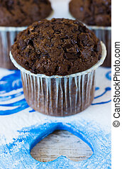 Chocolate muffin and heart - Chocolate muffins on the board...