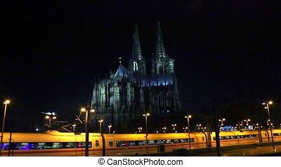 Cologne Koeln, Cathedral and Hohenzollernbrucke at night. -...