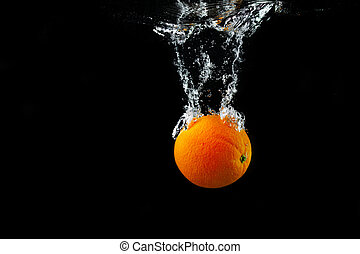Orange in water - Fresh orange falling into the water with a...