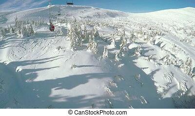 Riding ski lift - Couple riding ski lift