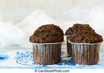 Four chocolate muffins - Chocolate muffins on the board...