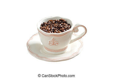 coffee beans in a white cup and saucer isolated
