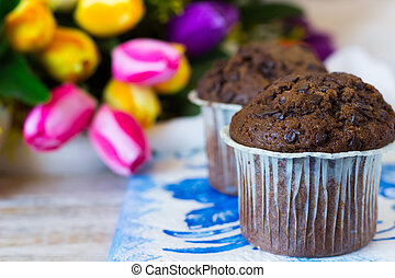 Chocolate muffins on a mother's day in the flowers...