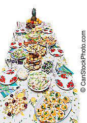 holiday table with dishes, with different dishes, salads isolated