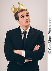 Handsome young prince - Handsome young man in suit and crown...