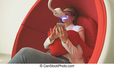 Woman client sitting in chair during whitening - Attractive...