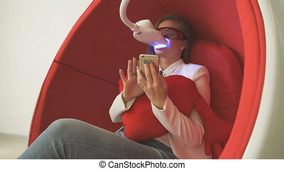 Woman client sitting in chair during whitening