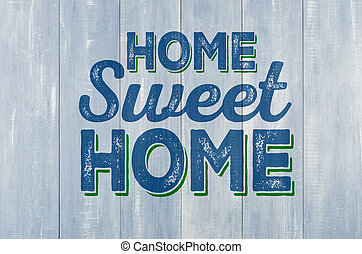 Blue wooden wall with the inscription Home sweet home