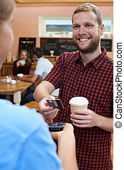 Customer Paying For Takeaway Coffee Using Contactless...