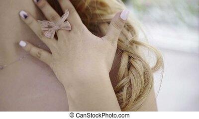 Cute young blonde woman touching her body shot