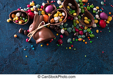Delicious chocolate easter eggs ,bunny and sweets on dark...